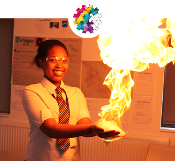 Photograph of sixth form student holding a ball of fire at Crewe Engineering & Design UTC
